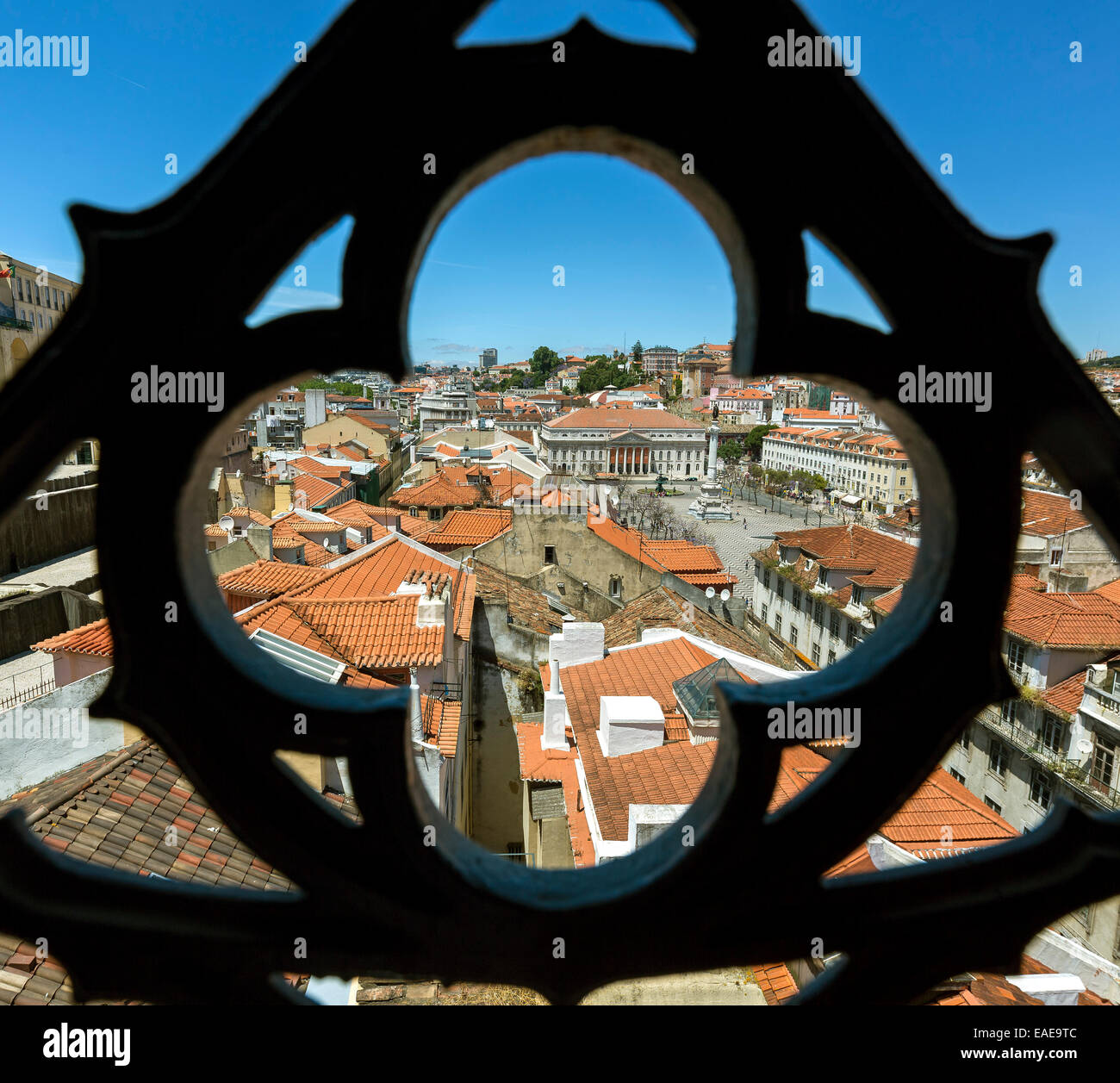 Outlook through a wrought iron grid of Santa Justa Elevator, Elevador de Santa Justa or Elevador do Carmo, over - Stock Image