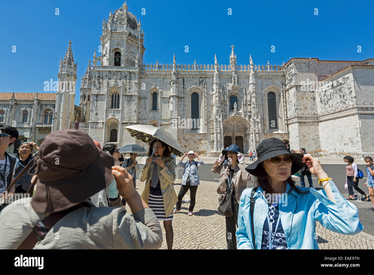 Japanese tourists in front of the Mosteiro dos Jerónimos, Jeronimos Monastery, UNESCO World Cultural Heritage Site, Stock Photo
