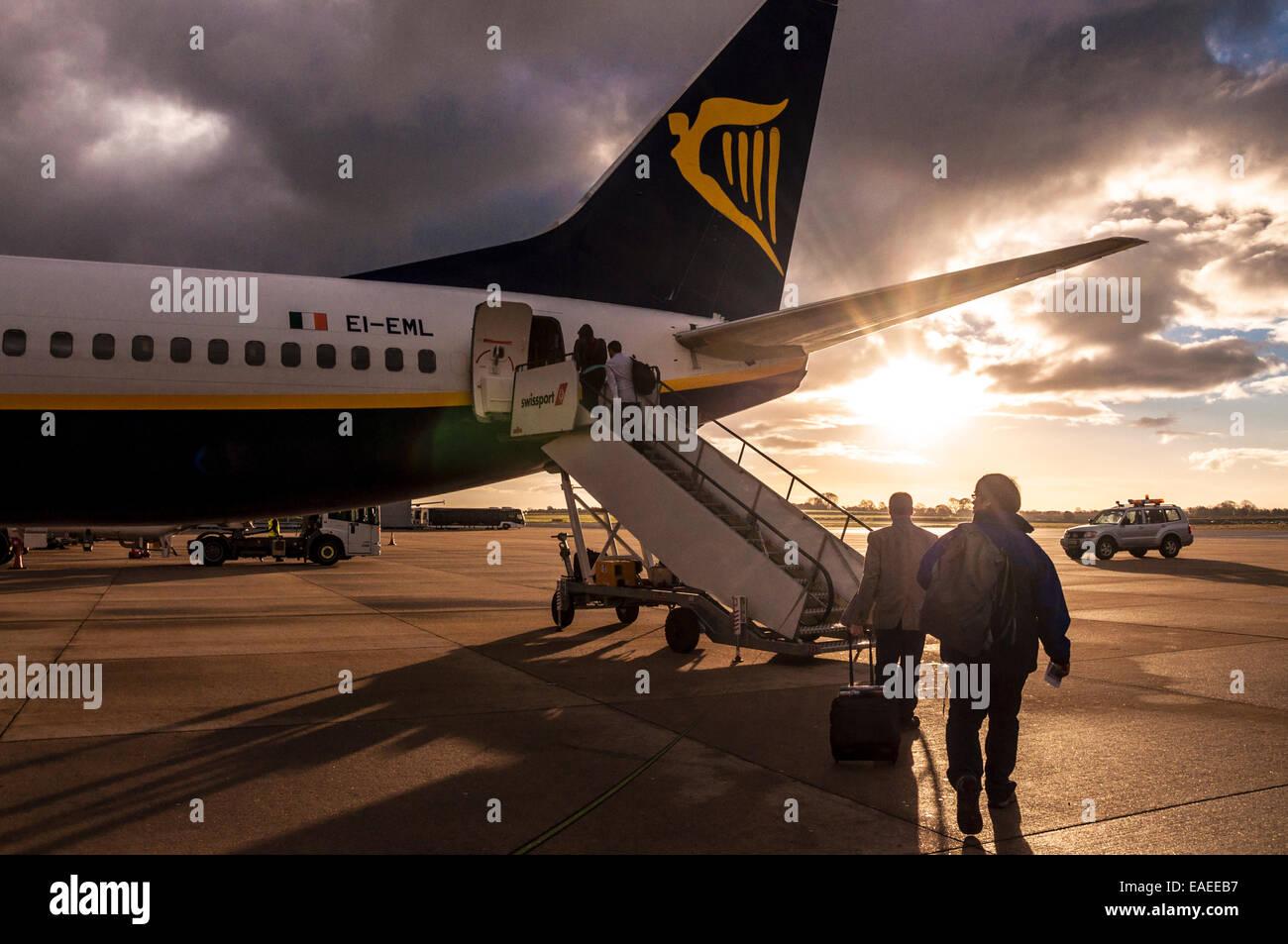 Boarding a Ryanair flight at Bristol Airport UK at sunrise - Stock Image