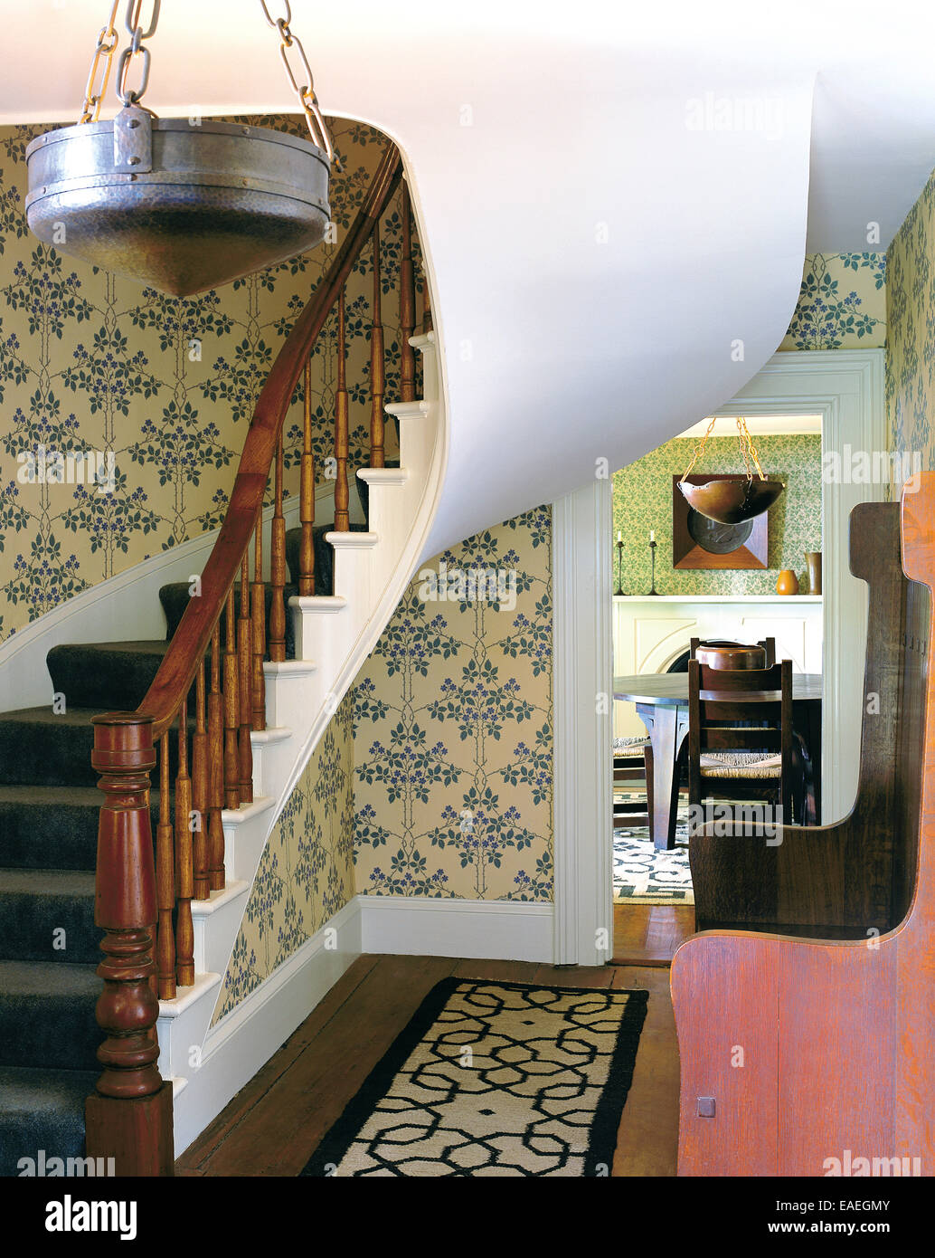 Curved Stairway And Entrance Way With Arts And Crafts