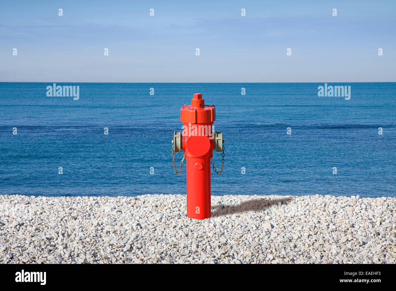 A hydrant at the seaside. Plenty of water: concept image - Stock Image
