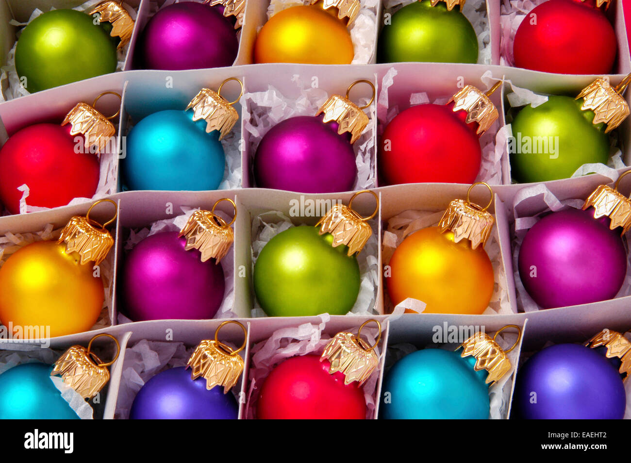 Christmas Ornaments Close up of a box of brightly colored glass ...