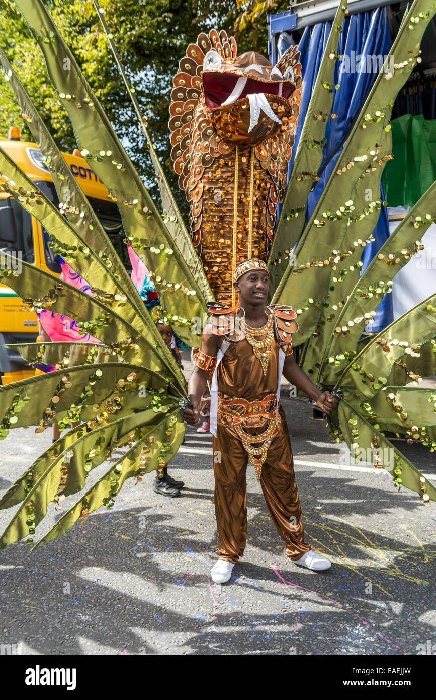 Dancers at the Notting Hill Carnival in London wear exotic and colourful costumes - Stock Image