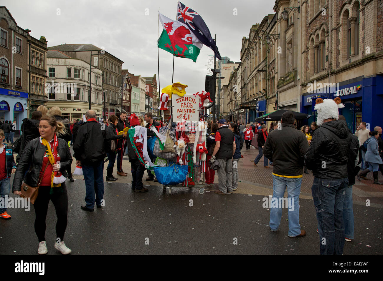 Street vendor selling souvenirs to rugby fans on the streets of Cardiff before the Wales v Australia match - Stock Image