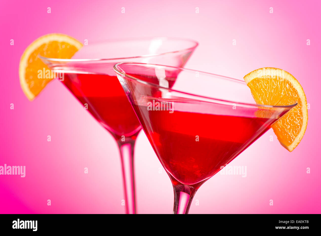 Two delicious cosmopolitan cocktails with cranberry juice, vodka, triple sec, and fresh squeezed lime juice with - Stock Image