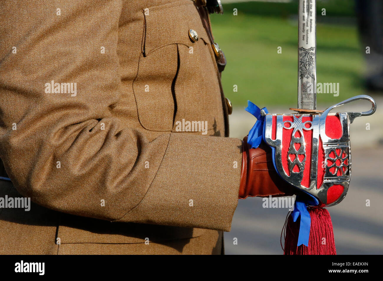 Officer in the British army, standing to attention with his ceremonial sword, Glasgow, Scotland, UK - Stock Image