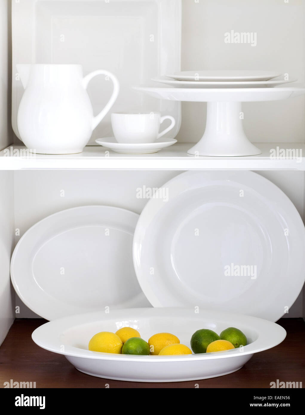 white plates, platter and charger - Stock Image