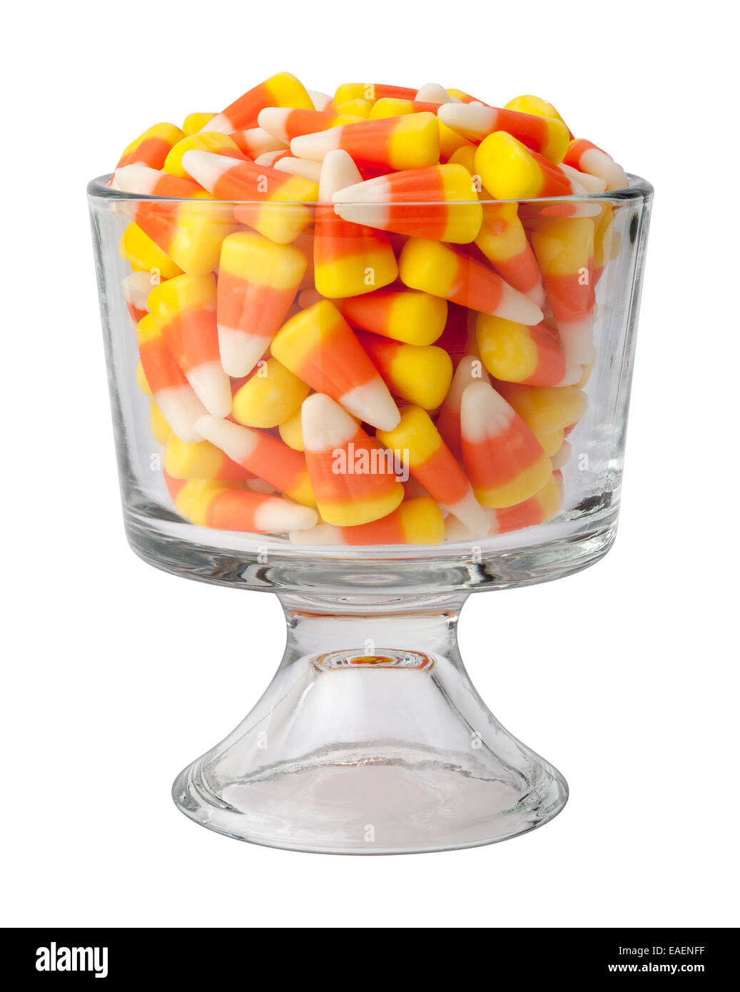 Candy corn in a dessert glass. - Stock Image