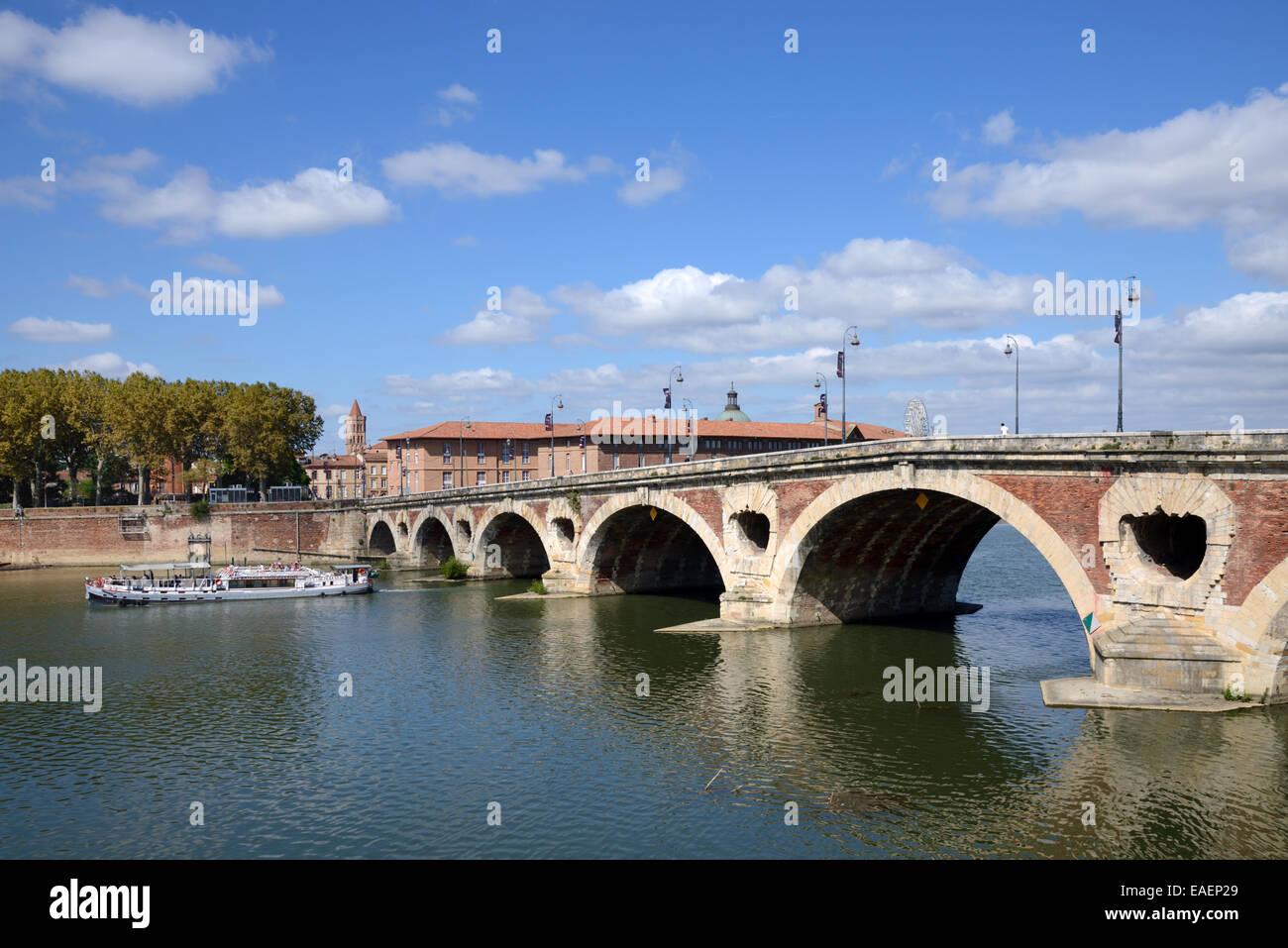 Cruise Boat or River Cruiser on Garonne River and Pont Neuf Bridge Toulouse Haute-Garonne France - Stock Image