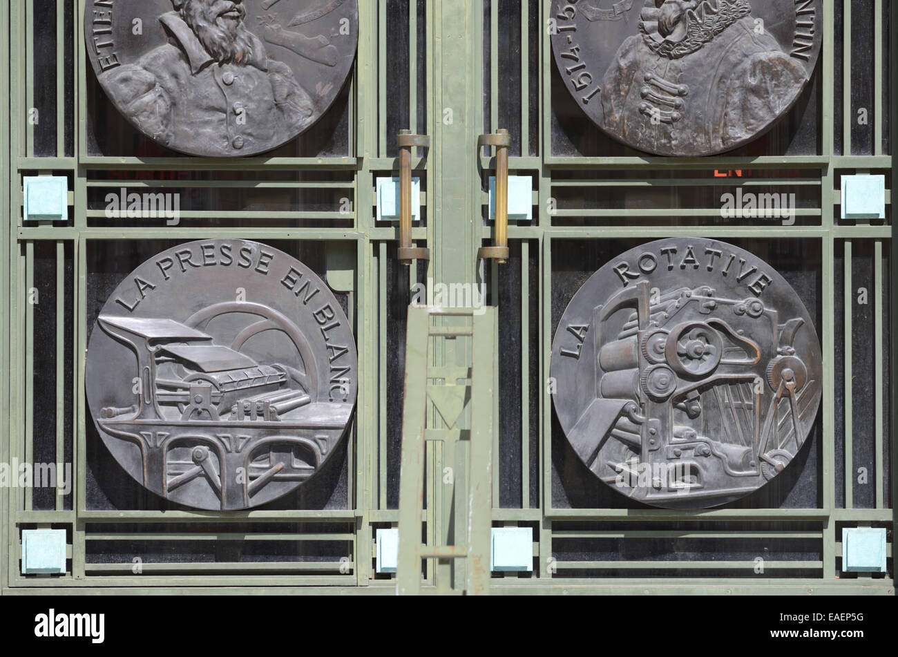 Printing Presses Medallions including Rotary Printing Press 1930s Municipal or Public Library Entrance Toulouse - Stock Image