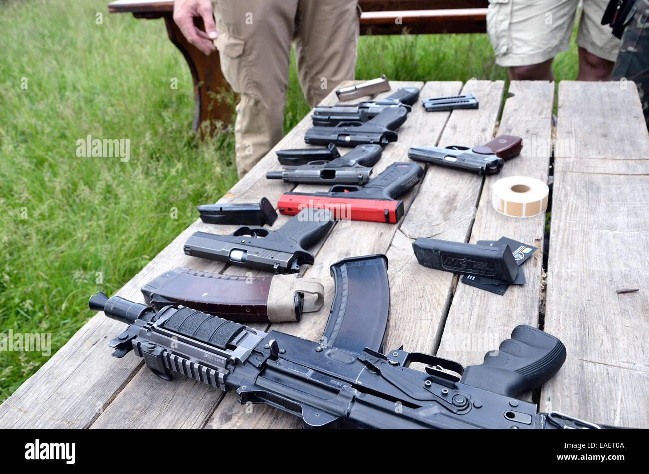 Portable guns on the table - Stock Image