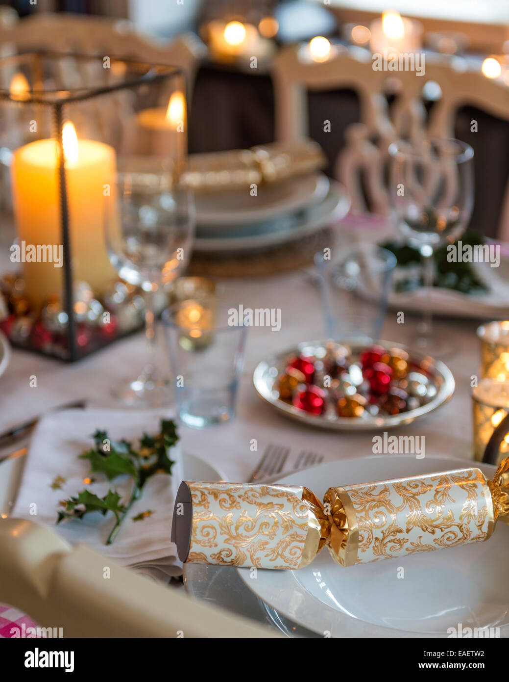 Detail of a christmas cracker at a laid table place - Stock Image