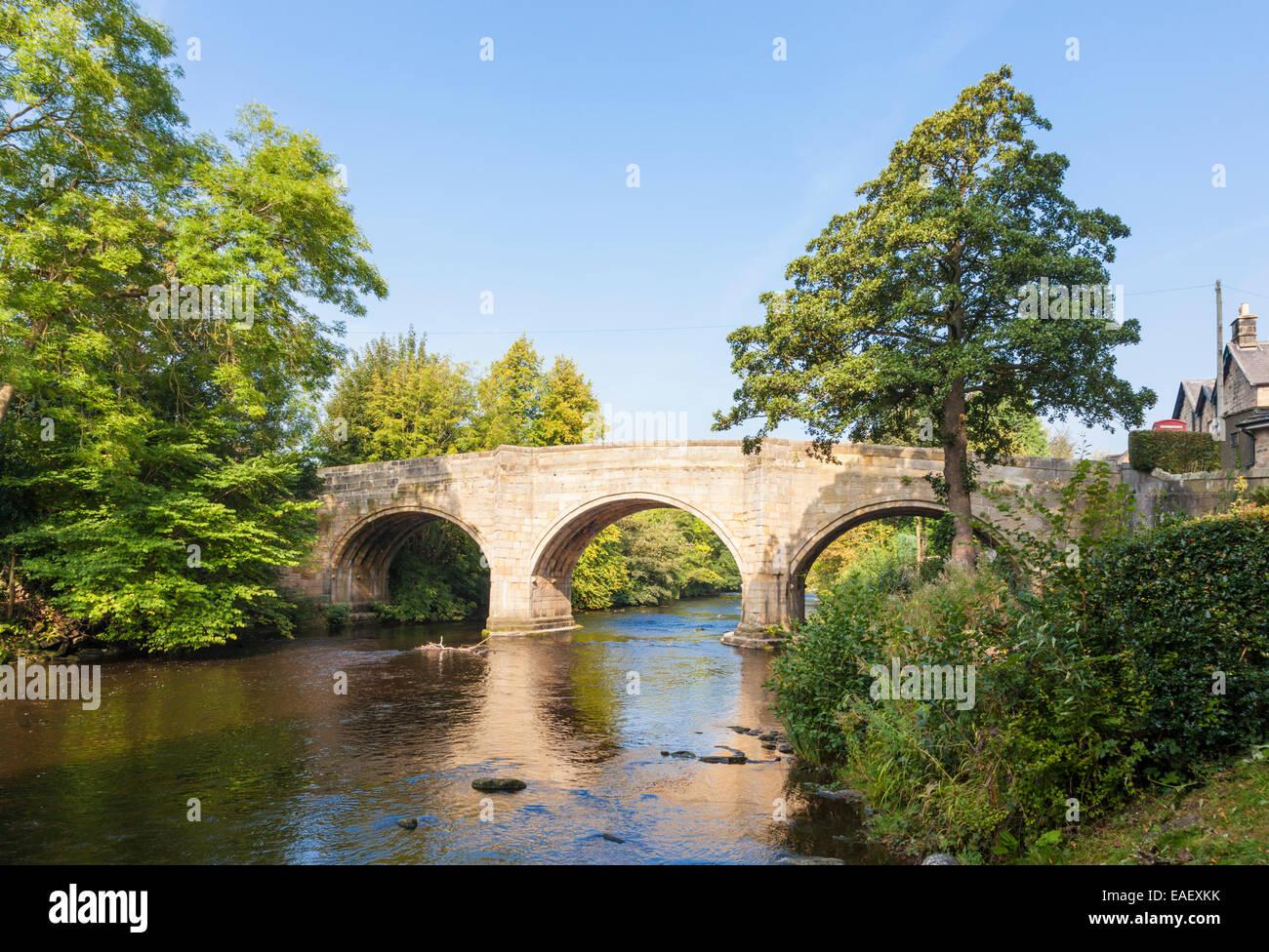 Bubnell Bridge over the River Derwent in the Peak District village of Baslow, Derbyshire, England, UK - Stock Image