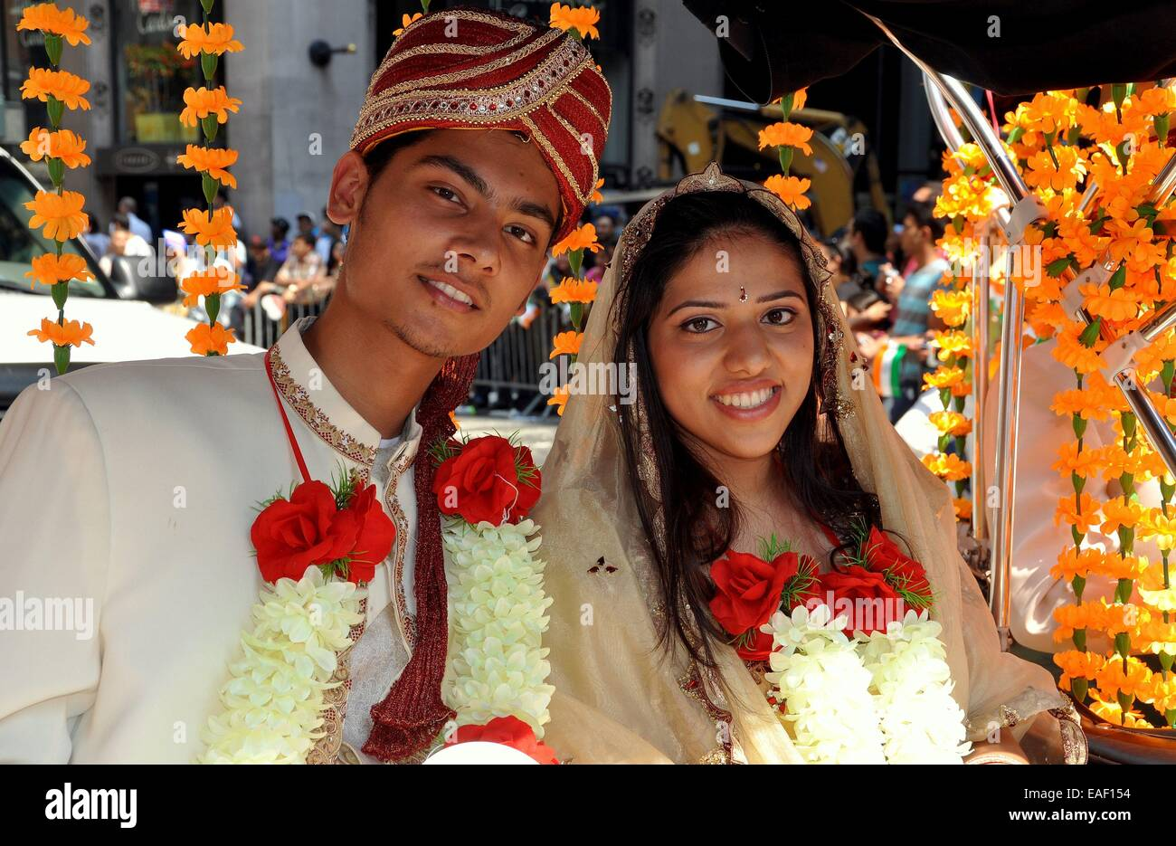NYC: A handsome young Indian couple in traditional marriage clothing ...
