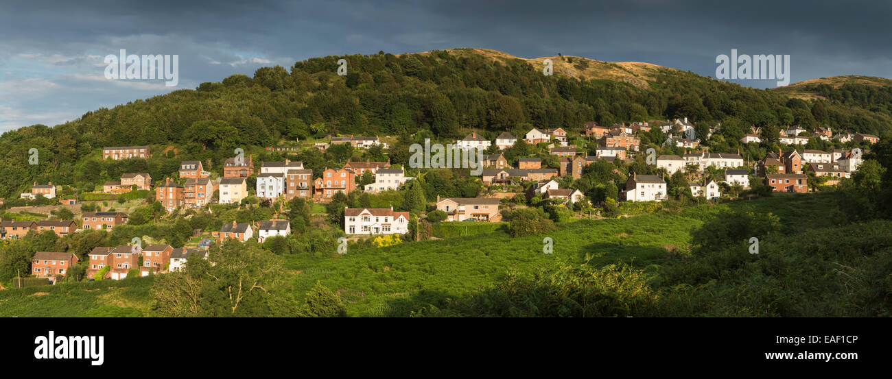 Houses of West Malvern on the side of the Malvern Hills at sunset Stock Photo