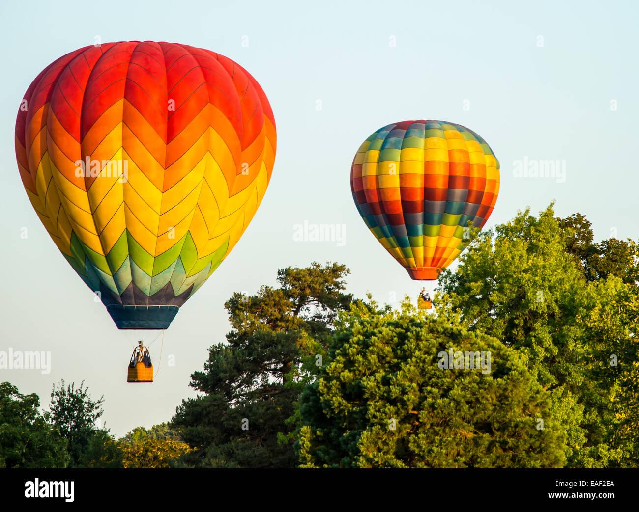 Colorful Hot Air Balloons hovering over trees in Ann Morrison Park. Spirit of Boise Ballloon Festival, Boise, Idaho, - Stock Image