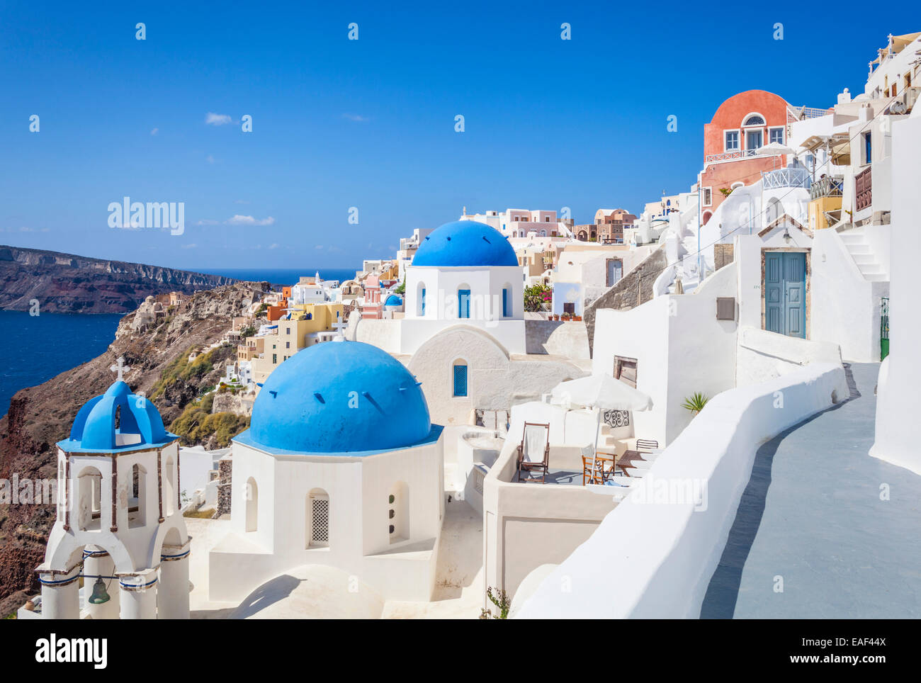 white houses and blue domes in the village of oia