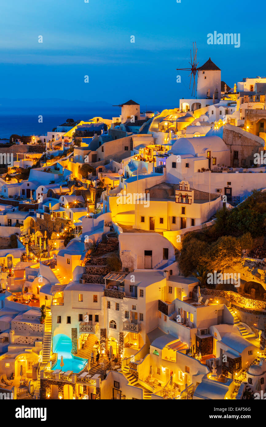 Windmill & white houses at night in the village of Oia, Santorini, Thira, Cyclades Islands, Greek Islands, Greece, - Stock Image
