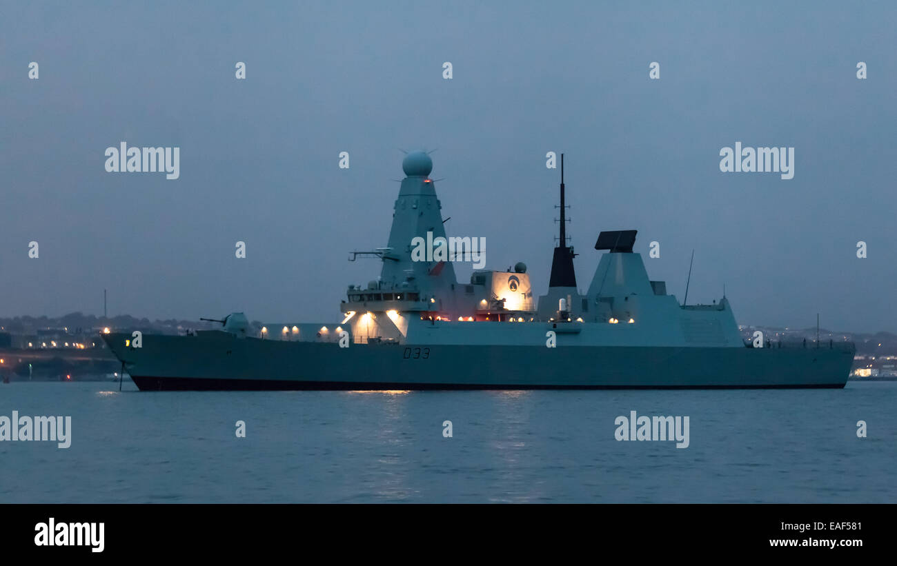 A British Navy ship in Plymouth harbor - Stock Image