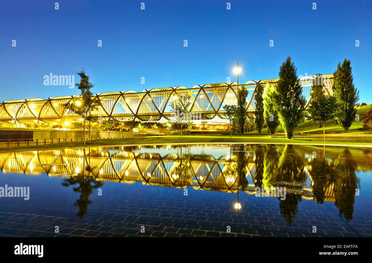 The sun sets over the Arganzuela bridge, designed by architect Dominique Perrault. Madrid Rio Park. Madrid. Spain Stock Photo