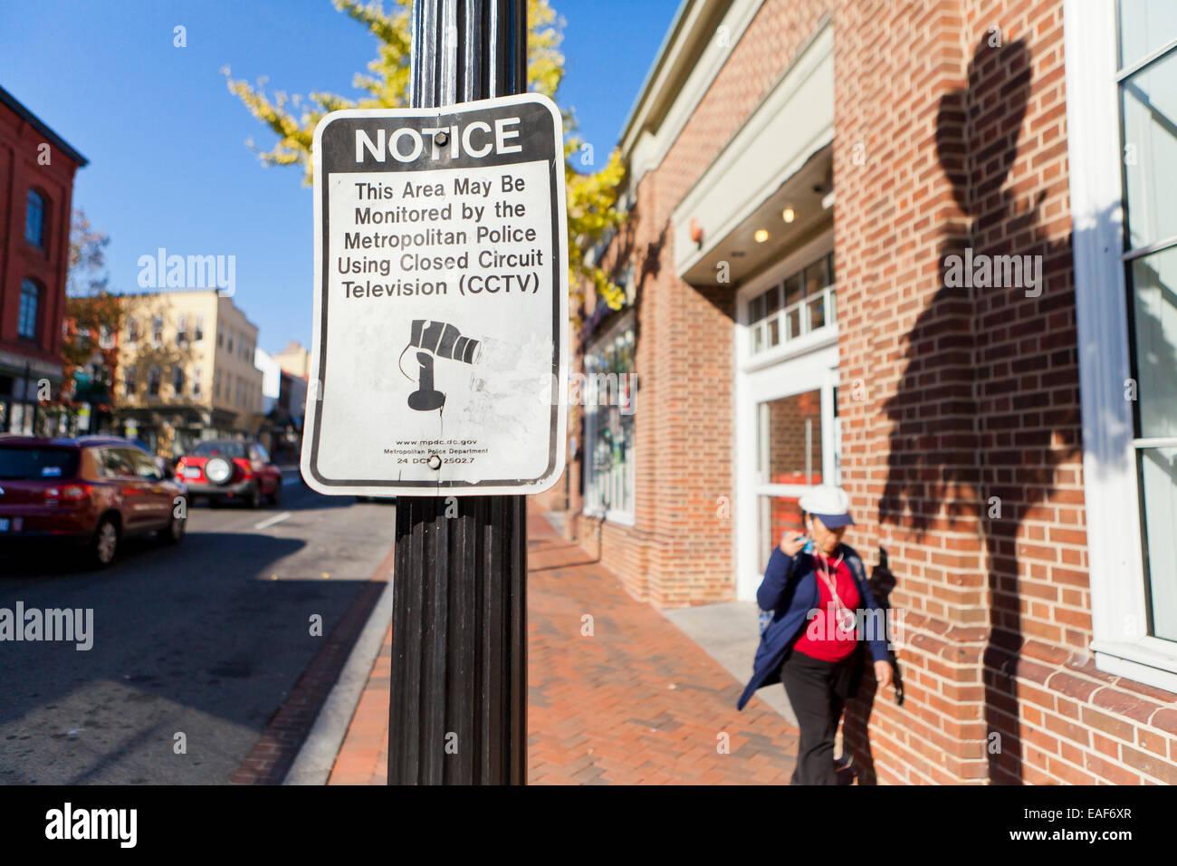 Police CCTV usage notice on public walkway - Washington, DC USA - Stock Image