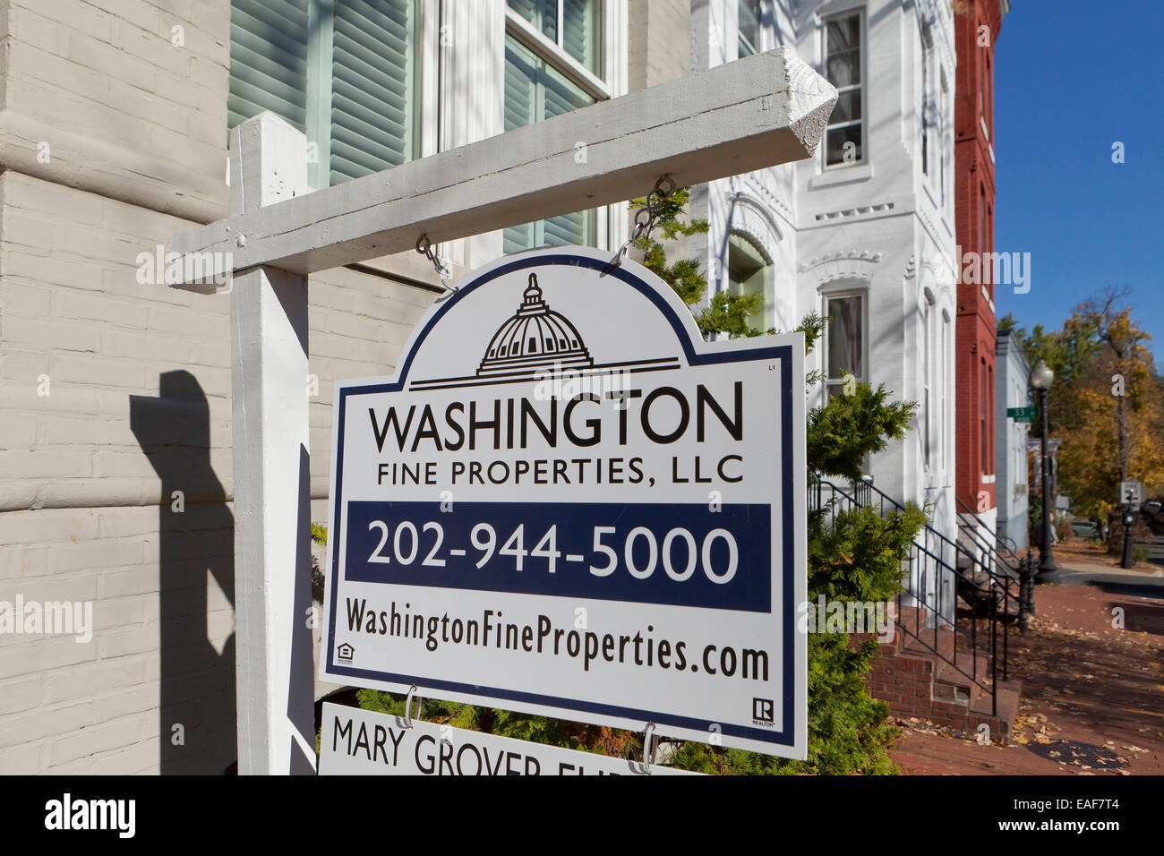 Realty sign on brick house - Georgetown, Washington, DC USA - Stock Image