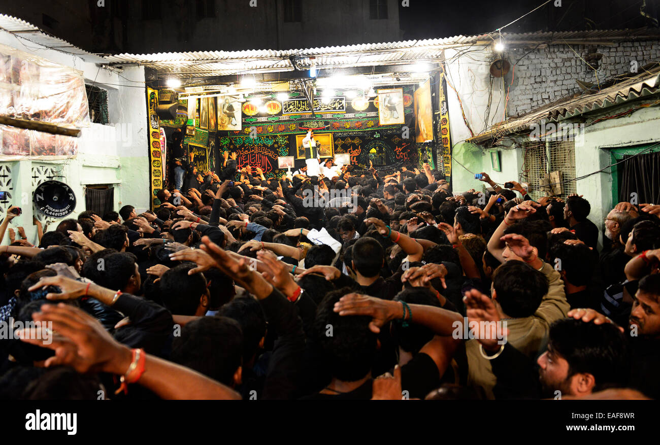 Shia men flog their heads during a mourning ceremony on the 8th day of Muharram. - Stock Image