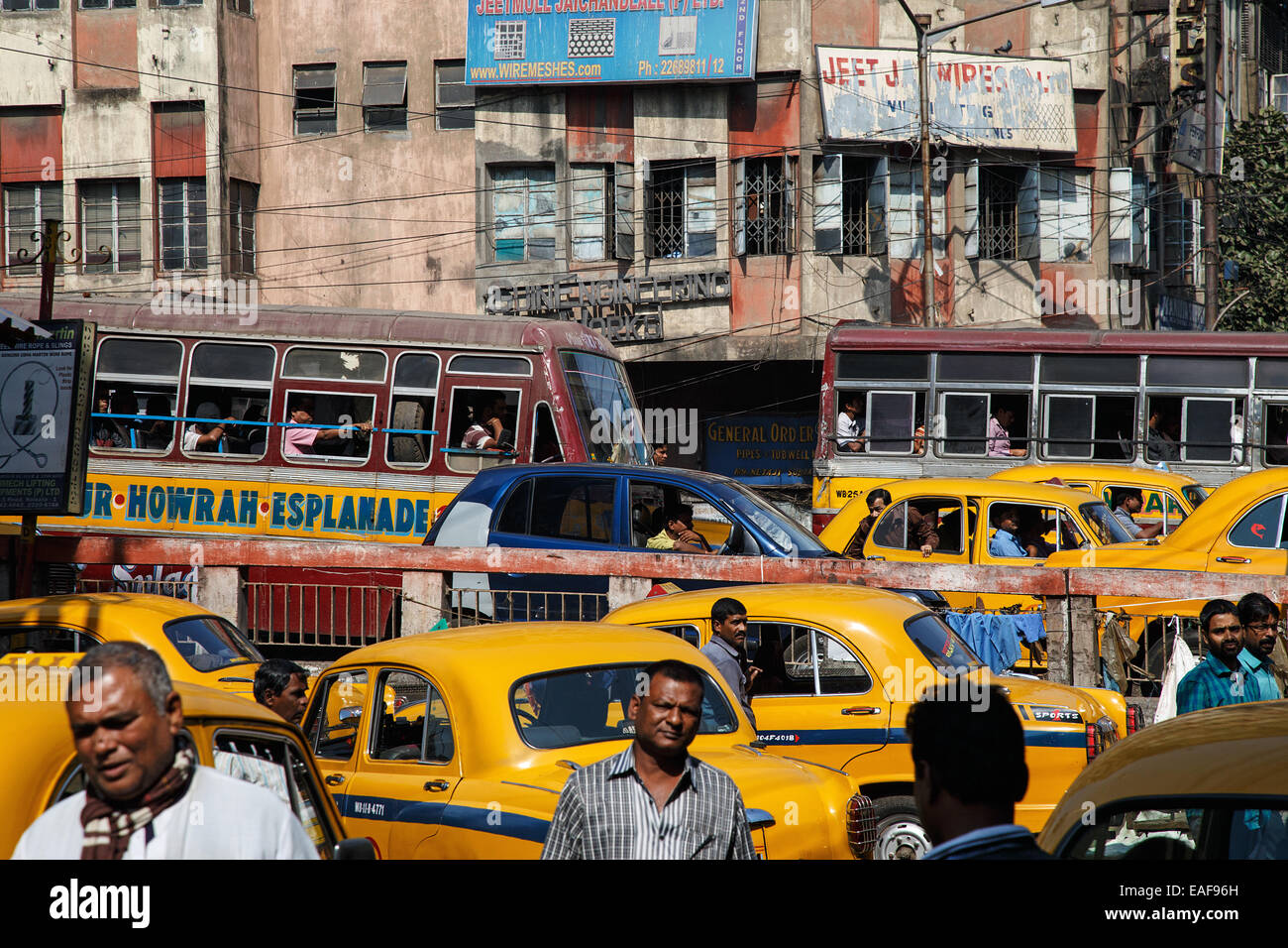 A road traffic with cars, taxis, buses and people on one of the main roads of Central Kolkata, India. - Stock Image