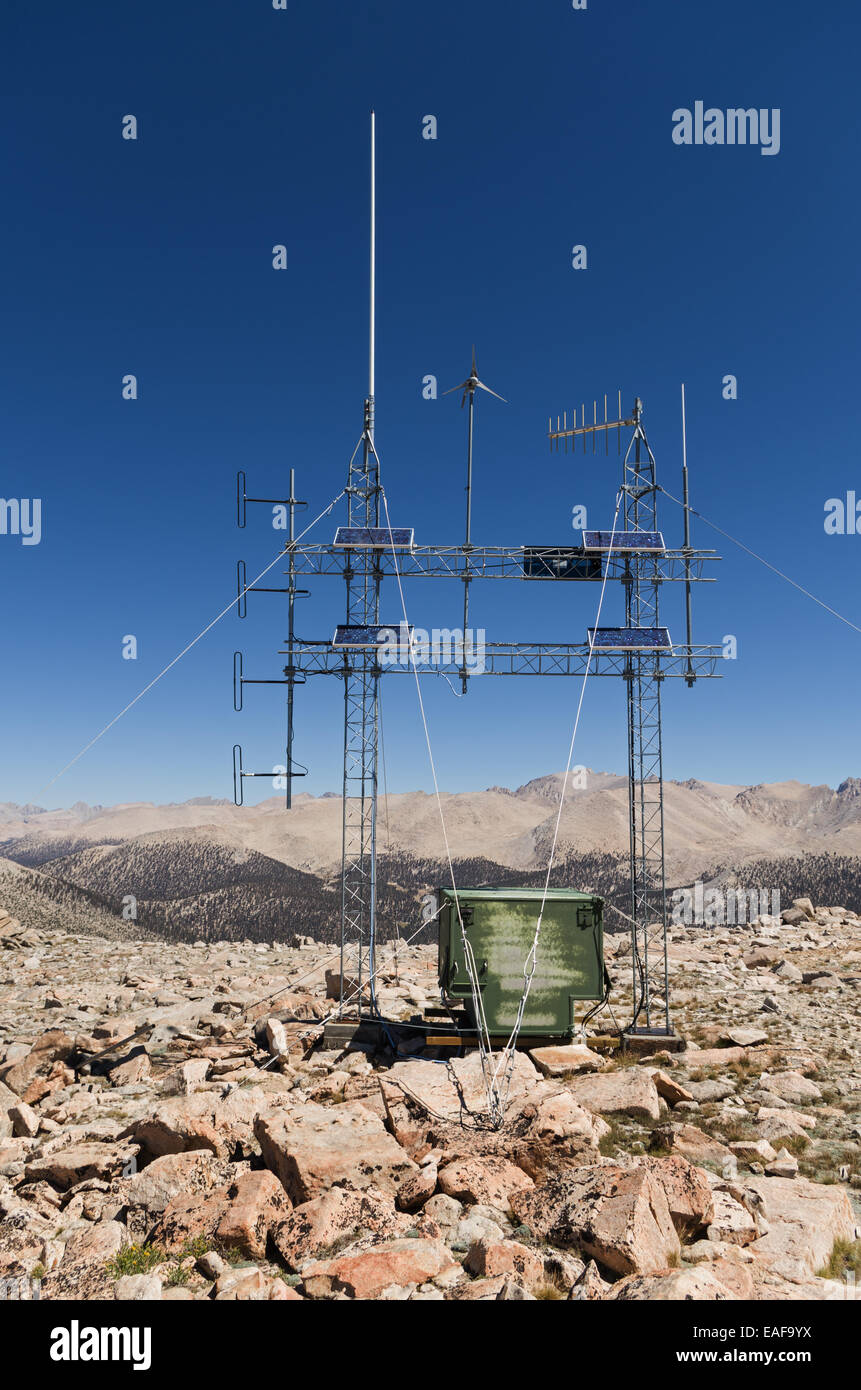 mountain top solar powered radio repeater antenna array with solar panels and wind generator - Stock Image