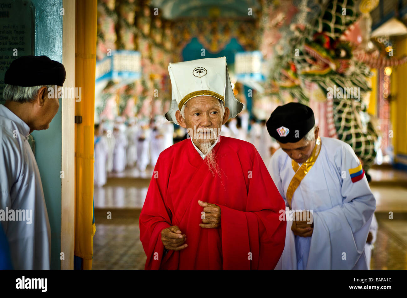 High priest  leaving the temple after twelve o'clock ritual,Cao Dai temple ,Tay Ninh ,Vietnam - Stock Image