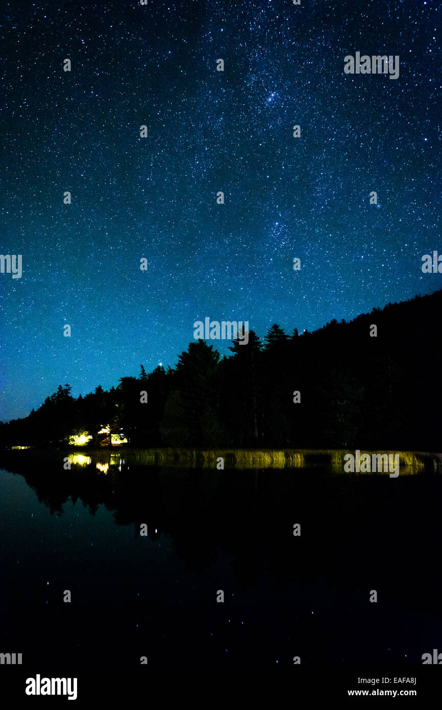 Stars in the night sky reflecting in Echo Lake, at Acadia National Park, Maine. - Stock Image