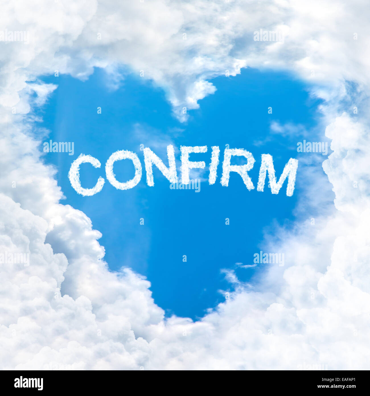 confirm word inside love cloud heart shape blue sky background only Stock Photo
