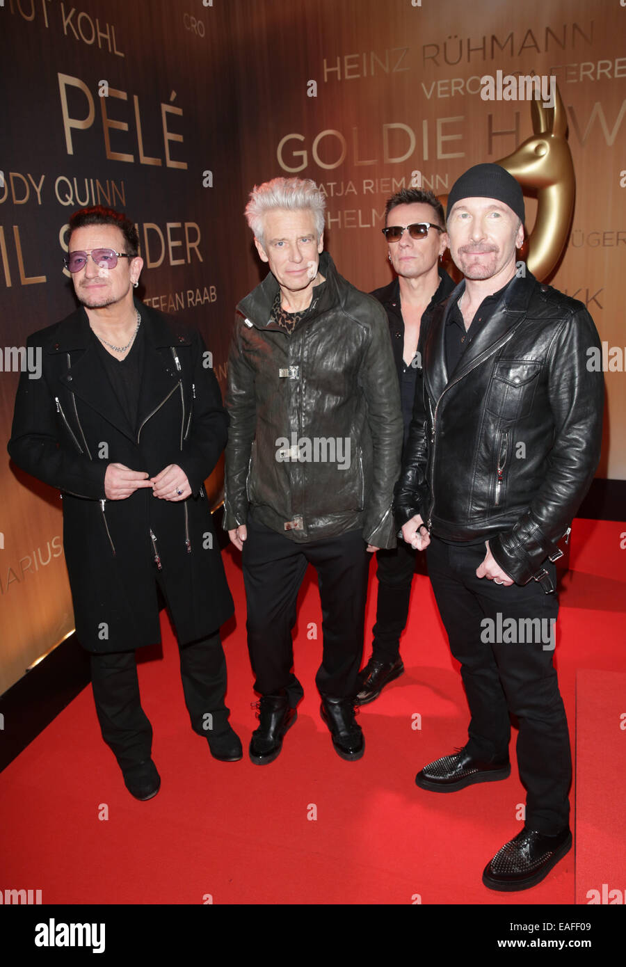 Berlin, Germany. 13th Nov, 2014. Irish band U2 with singer Bono (L) arrive on the red carpet before the Bambi Awards - Stock Image