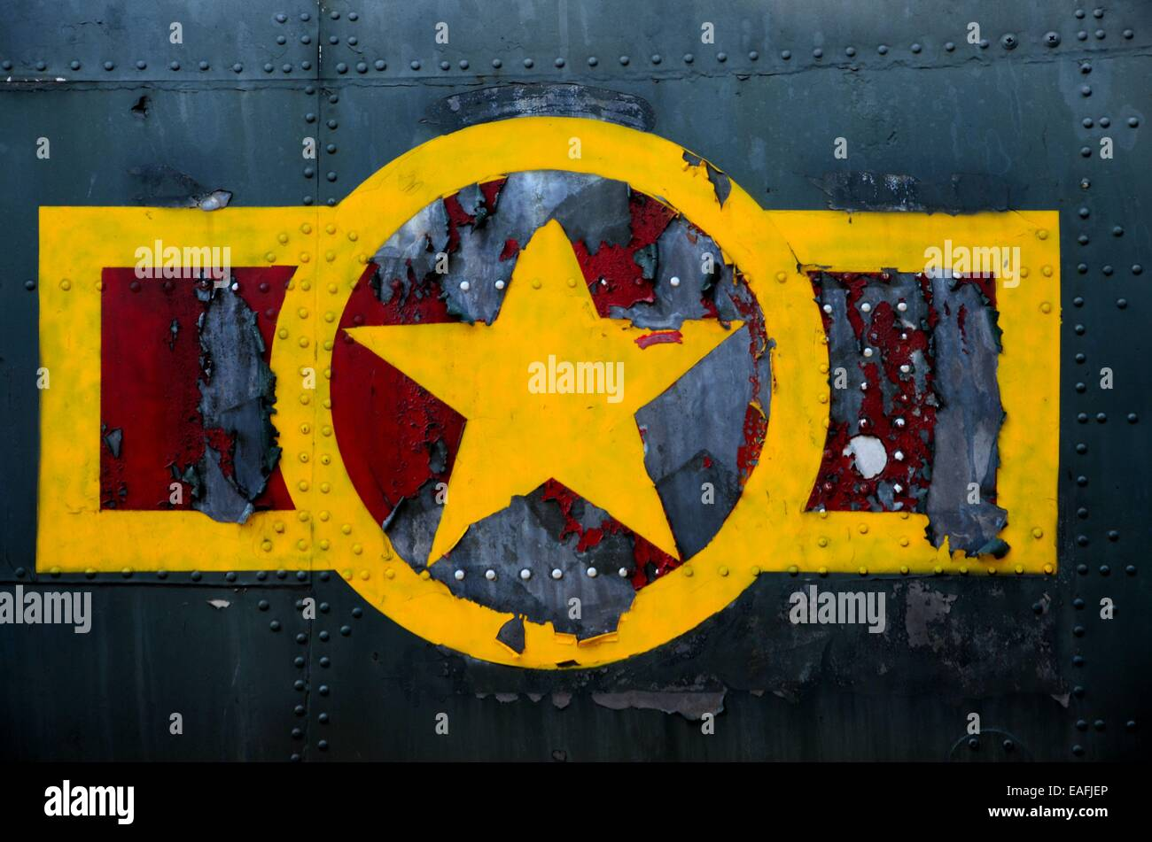 US military airplane fuselage with weathered stars and stripes logo - Stock Image