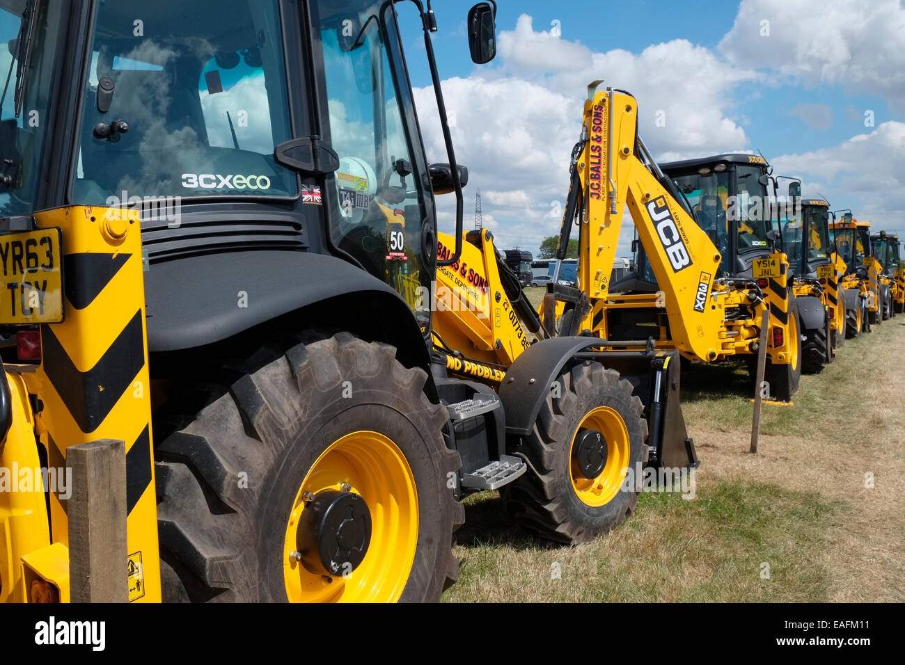 JCB diggers lined up at the Heckington Show, Lincolnshire, England. - Stock Image