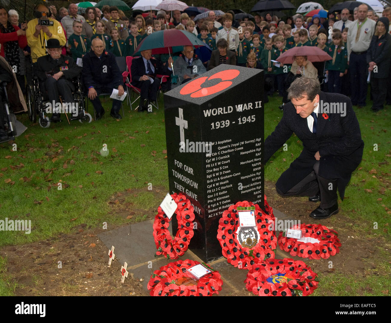 East Hampshire MP Damian Hinds placing wreath beside new war memorial on Remembrance Sunday, Four Marks, Alton, - Stock Image