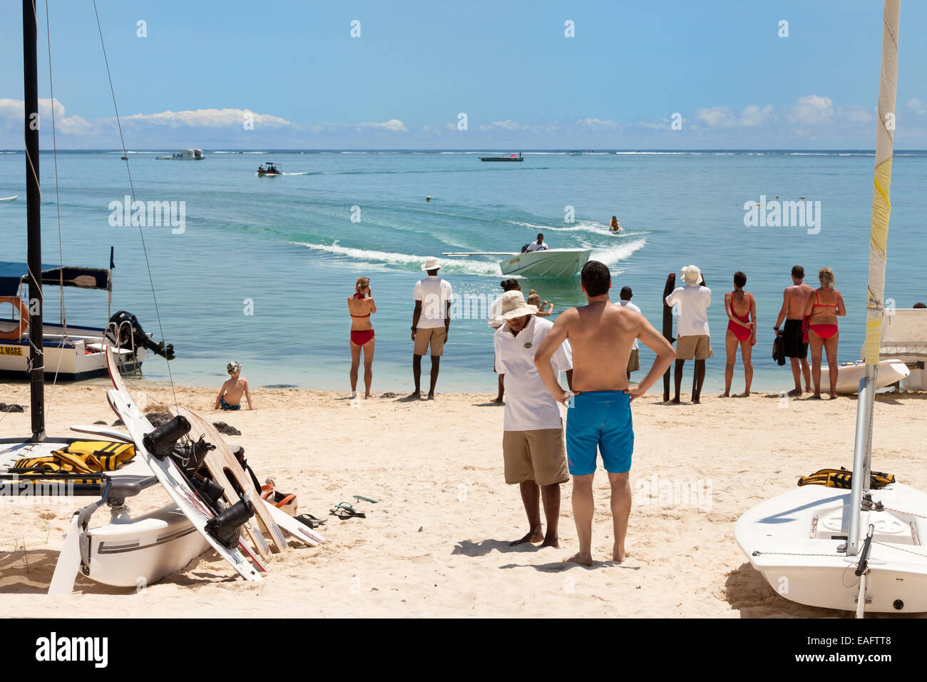 Tourists doing watersports, Belle Mare beach, east coast, Mauritius - Stock Image