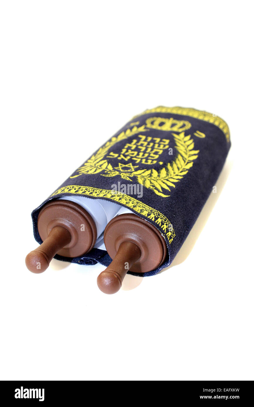 Torah scroll with cover on bright background - Stock Image