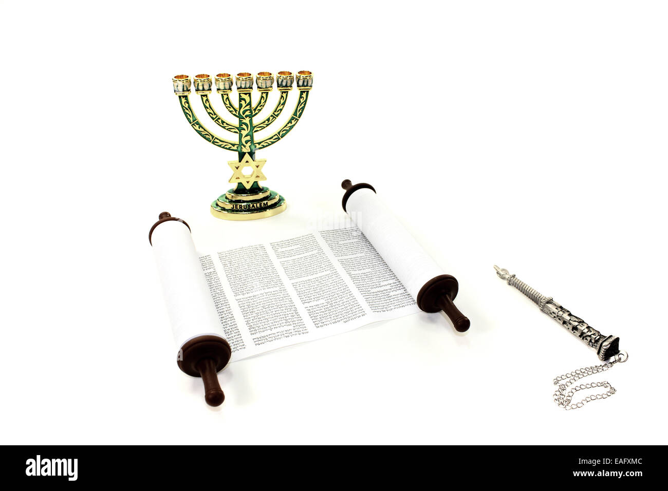 Torah scroll with menorah and pointer on light background - Stock Image