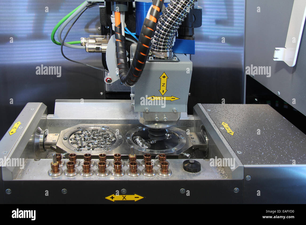 Dental CNC engraver in action. Dental milling machine carving out previously  scanned and computer manipulated model - Stock Image
