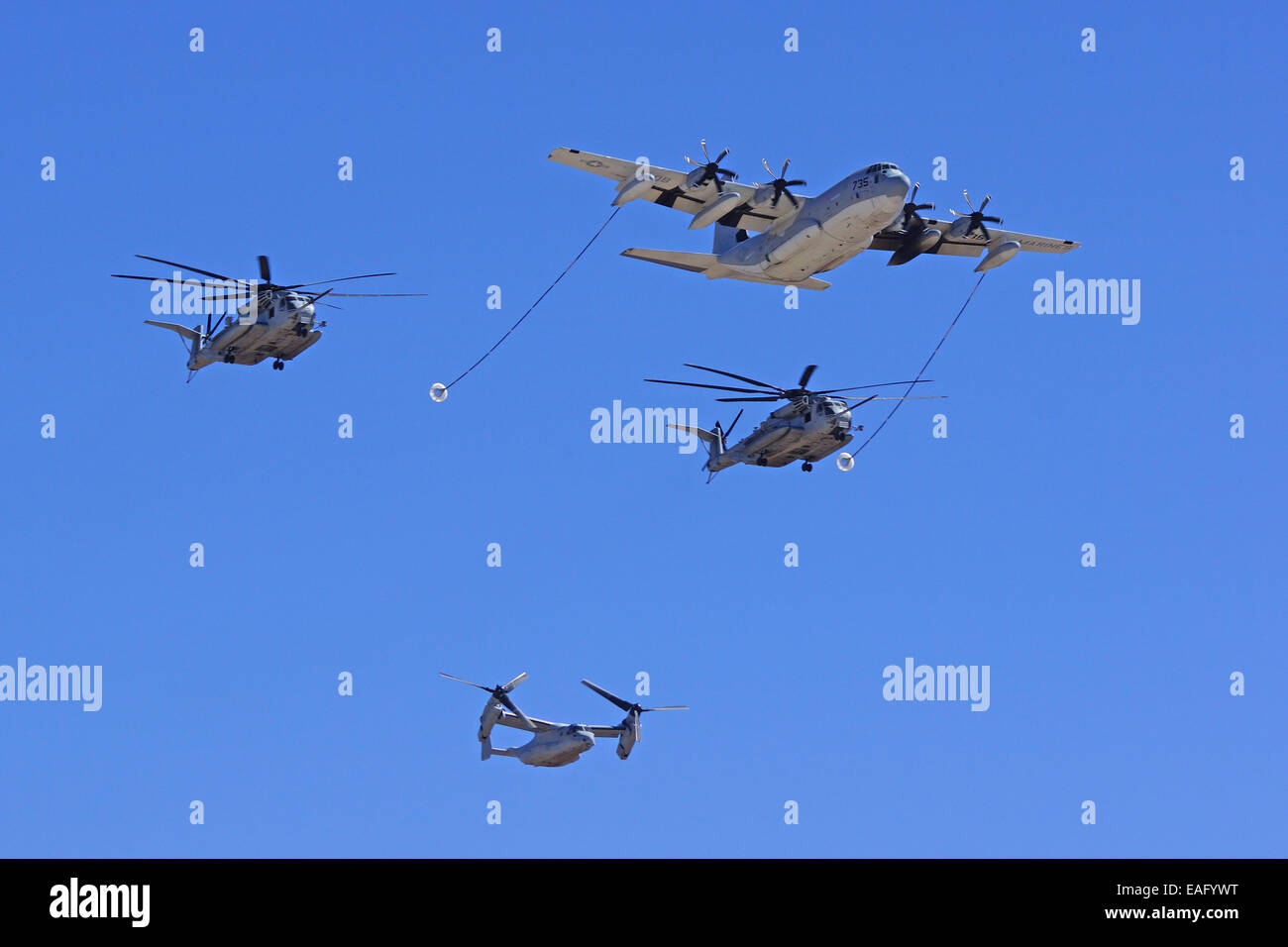 C-130 Refueling CH-53 Super Stallion and MV-22 Osprey at the 2014 Miramar Air Show - Stock Image