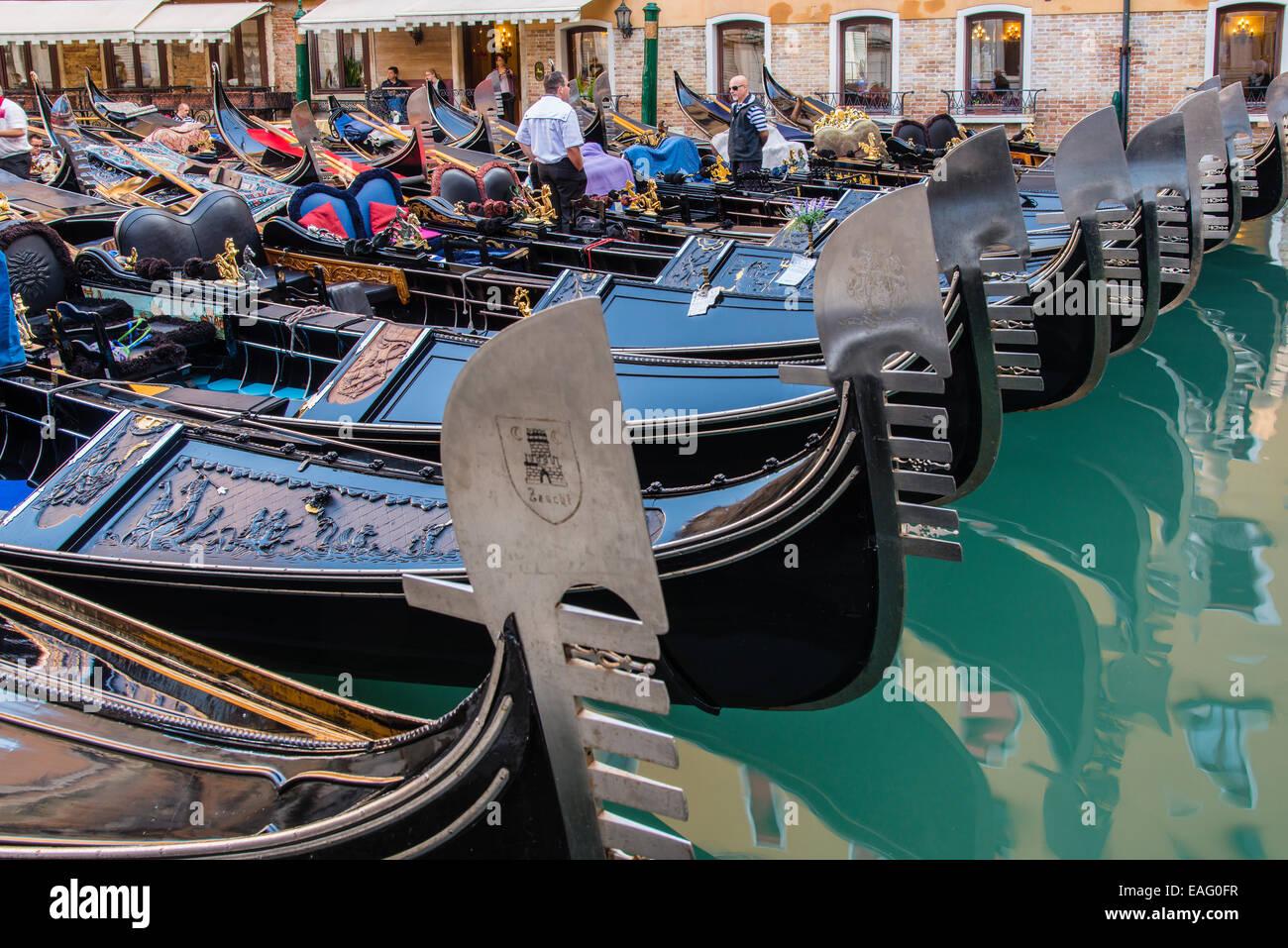 Bows of gondolas in a row, Venice, Veneto, Italy - Stock Image