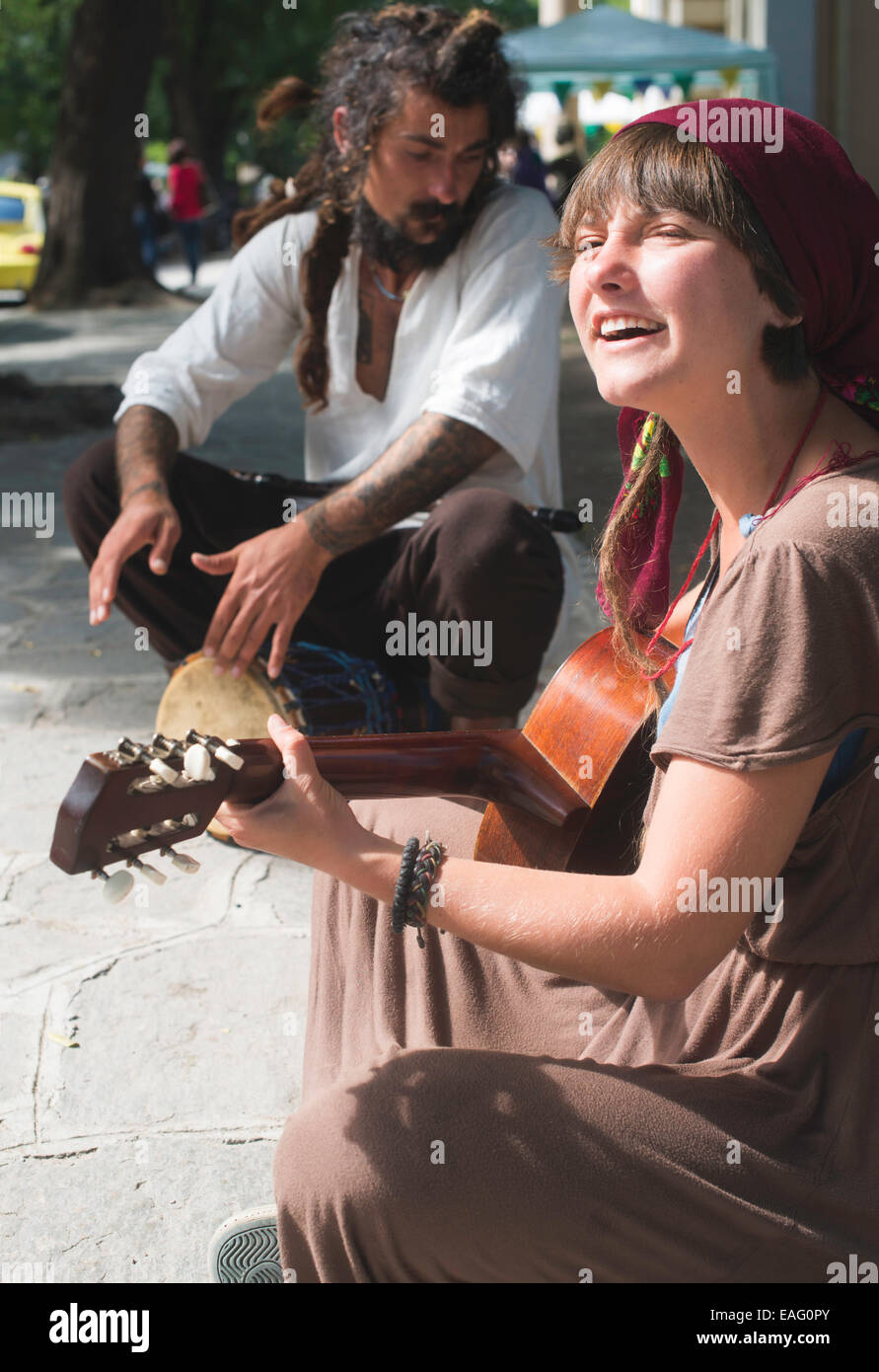 Street musicians playing guitar and drum - Stock Image