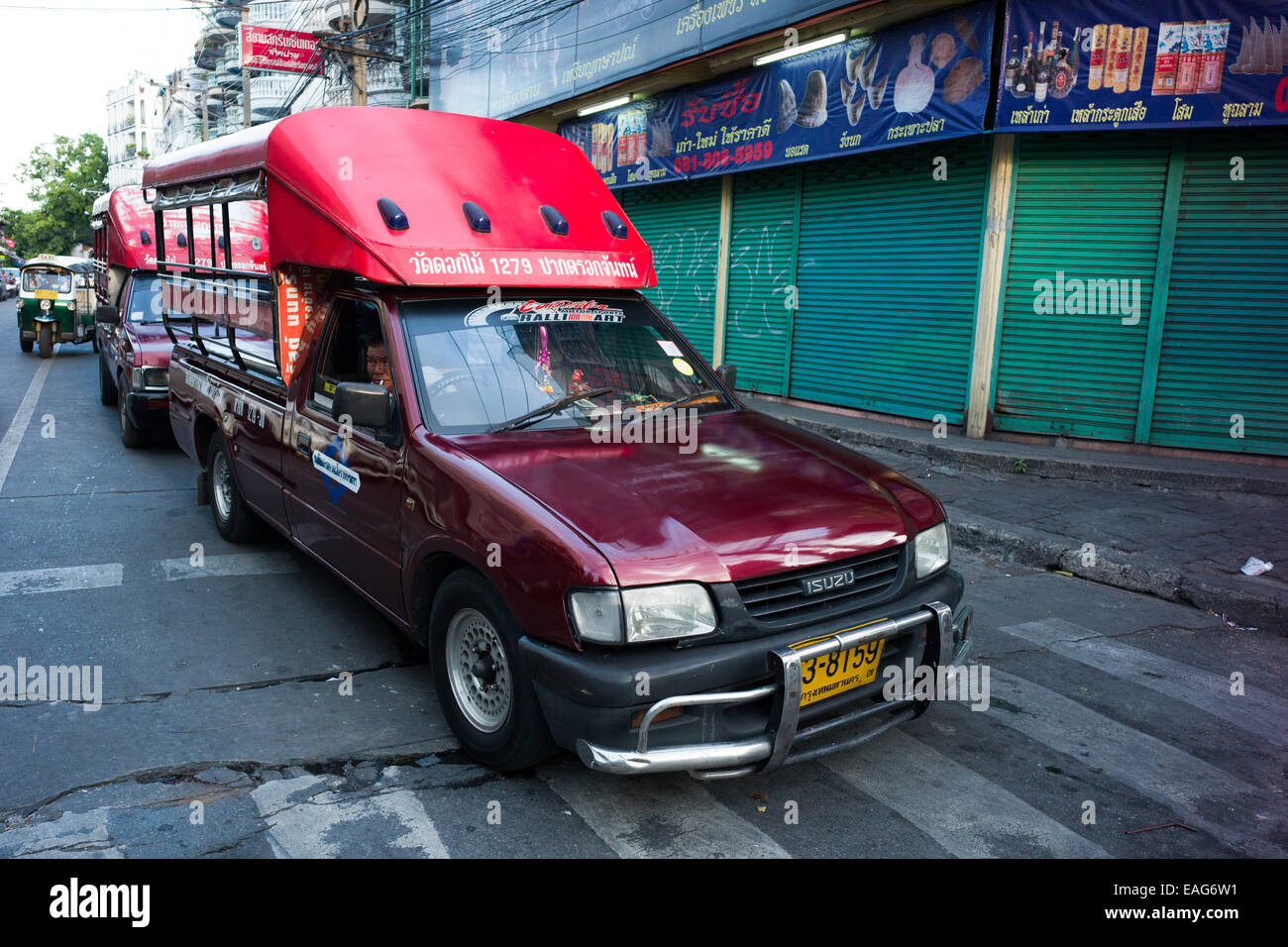 Songthaew public transportation truck, Charoenkrung road, Bangkok, Thailand. - Stock Image