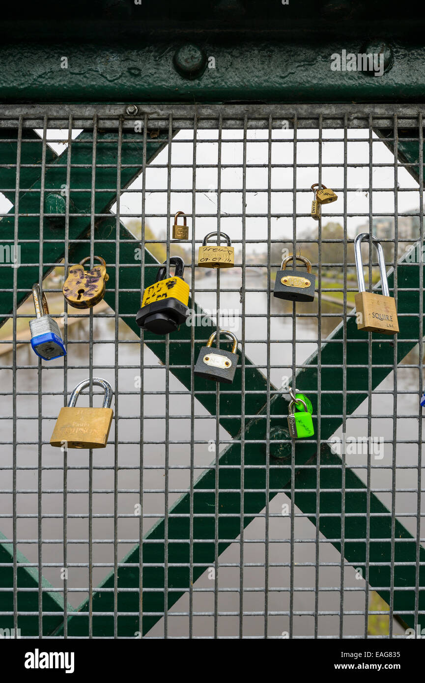 A current fad - Padlocks left on a York railway bridge fence that signify a commitment to a romantic loving relationship. - Stock Image