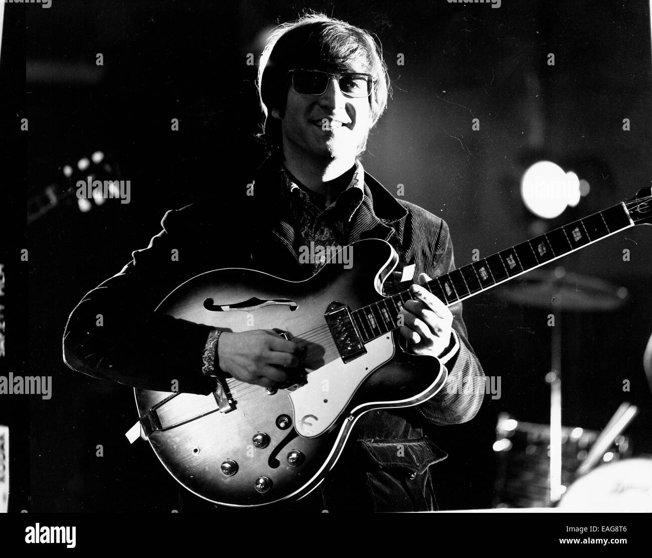Singer And Songwriter JOHN LENNON 1940 1980 Was A Member Of The Beatles Legendary English Rock Band PICTURED Lennon Playing Guitar During