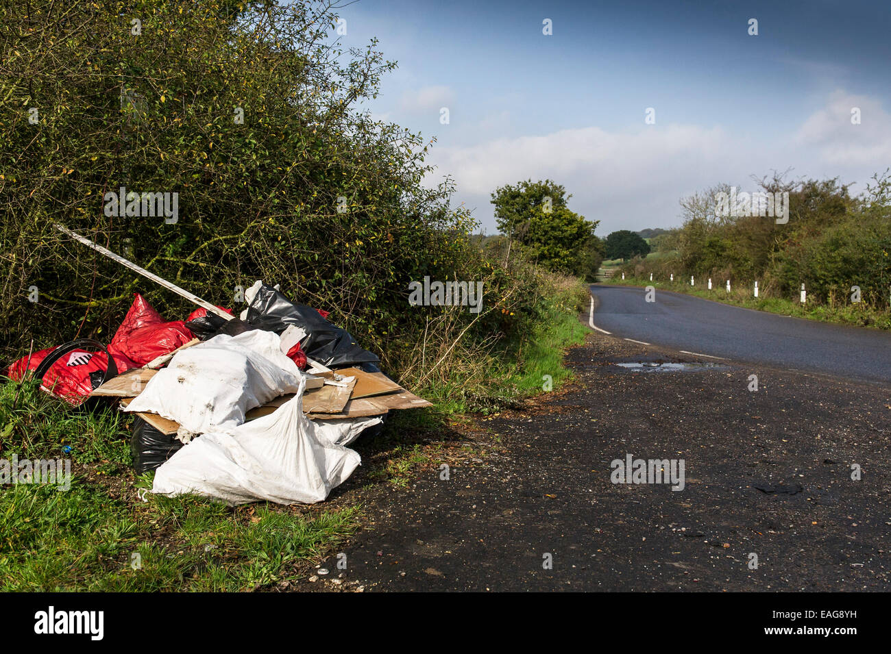 Fly tipping in a lay-by on a road in Essex - Stock Image