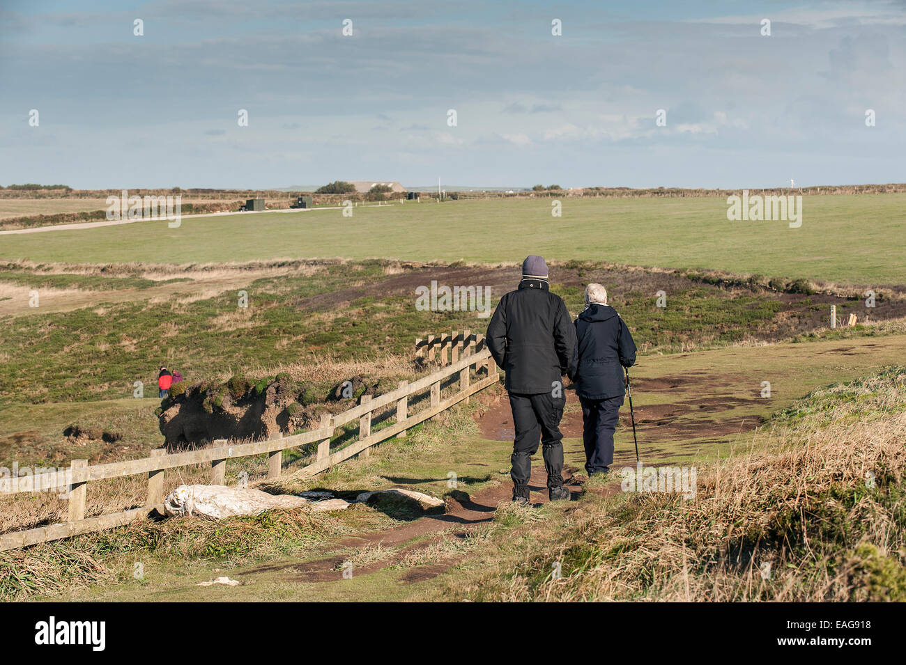 Walkers on the North Cornwall Coast. - Stock Image