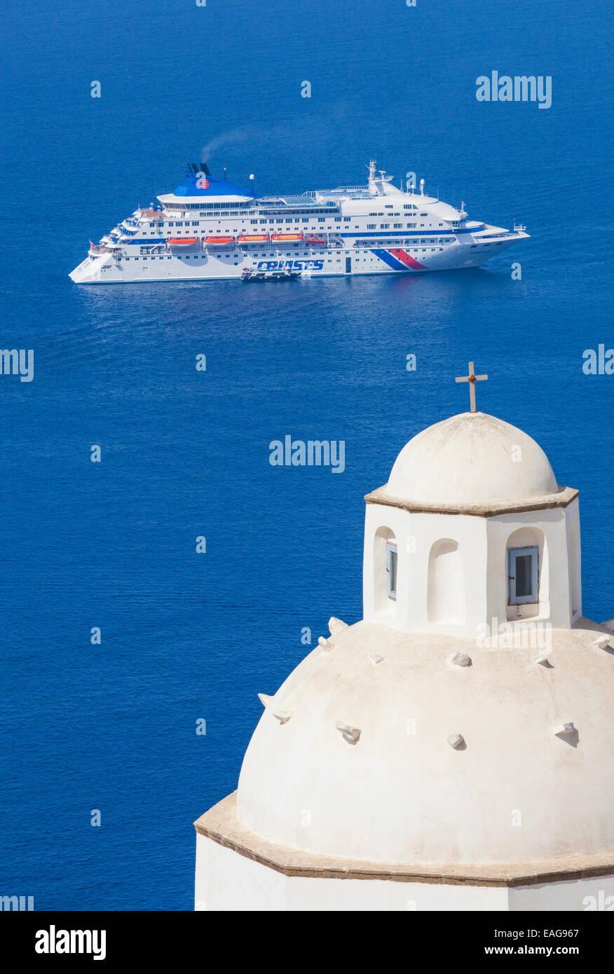 White dome of the church of Agios Minas and cruise ship Fira Santorini, Thira, Cyclades islands, Aegean Sea, Greece, - Stock Image