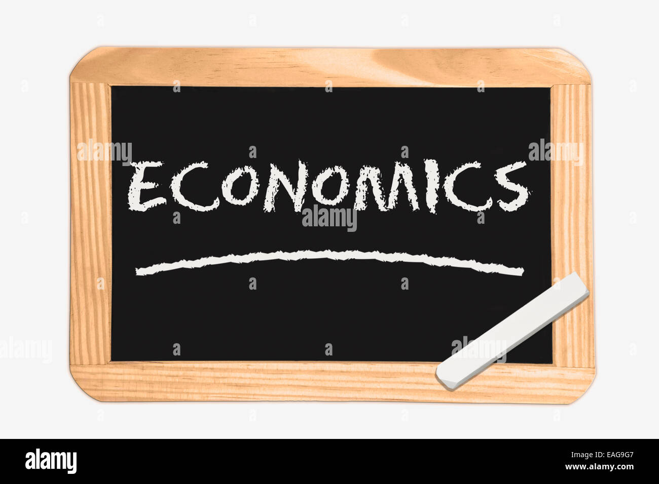 Blackboard with the inscription Economics, a piece of white chalk in the corner - Stock Image